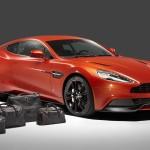 Le Aston Martin Personalizzate da Q in mostra a Pebble Beach - La Vanquish con bagagli di fianco