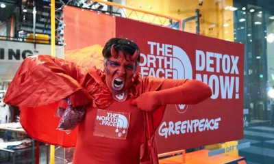 Greenpeace a Milano, coriandoli rossi contro The North Face